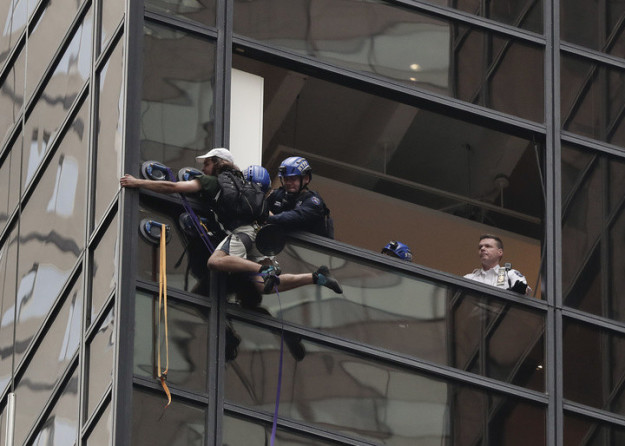 Police could be seen breaking windows and removing air vents from the side of the Trump building.