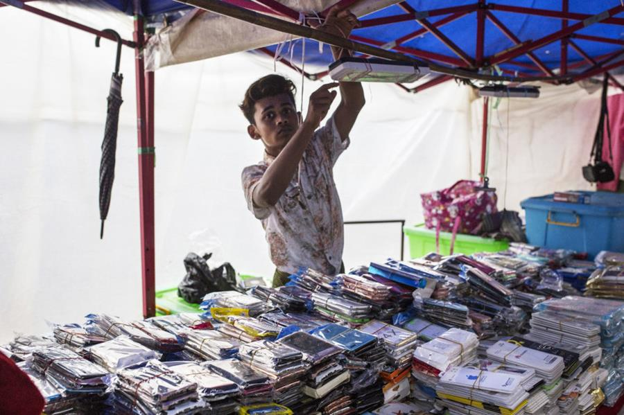 A street vendor selling mobile phone accessories in Yangon on July 17.