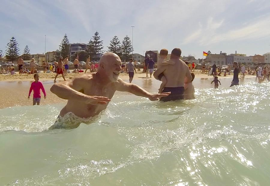 Keen surf race competitor jumps into the waves